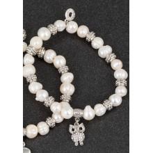 Apyrankė pelėda pasidabruota su natūraliais perlais