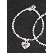 Apyrankė pasidabruota širdelė su violetiniais akmenukais